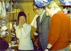 Arthur Rankin, Jr. and Danny Kaye admire the artistic talents of Kyoko Kito.